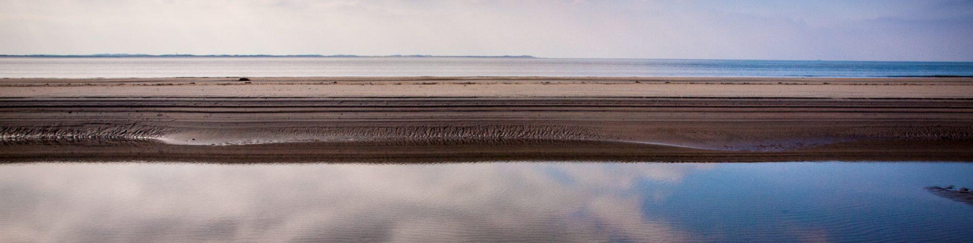 Rømø Strand bei Ebbe Urlaub mit Baby